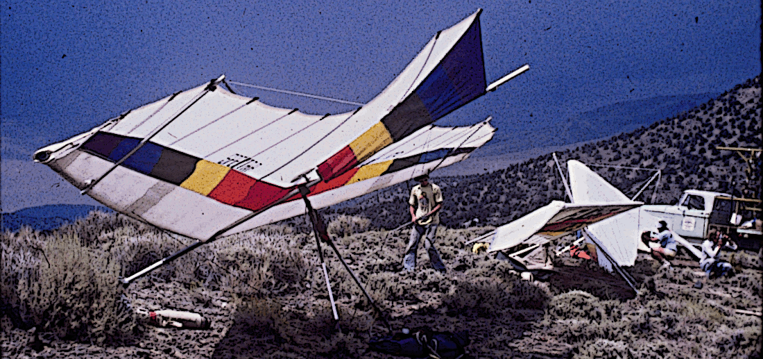 The second prototype of the Spectra Aolus hang glider stands next to Eric Raymond's Sunseed on Paiute Launch, but a thunderstorm is moving in.  For a while, the hang gliders buzzed, charged with electricity, as we stood back in apprehension!